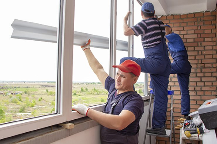 master workers install window sill repair in house building Asians